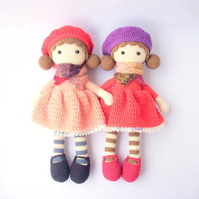 Colorful crochet amigurumi doll with scarfs and beanies