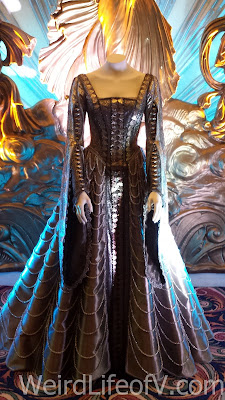 One of Emily Blunt's character, Freya, costumes on display in the theater lobby