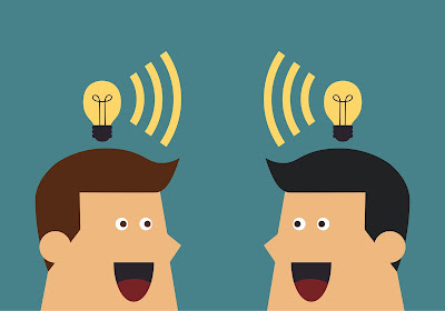 2 cartoon businessmen sharing ideas with light bulbs over their heads