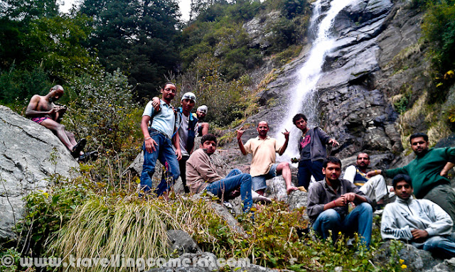 Apart from my heavy SLR Camera, I also carry a small Mobile phone by HTC which has a decent camera to shoot day pics anytime. All the photographs shared in this post are clicked by my Mobile Phone and I call it Mobilegiri :)The recent trip to Himachal Pradesh was quite exciting for different reasons. One of the reasons was meeting new friends during the journey. Here I am not talking about Parikshit. It's Billu, who is in his hands. A cute kitten. who met us on the way at Shawadh in kullu District.Everyone wanted to spend some time with this kitten. Aneesh is also trying to save her from chilly morning in Hills. He also took care of breakfast and all.After few minutes with Aneesh, she was quite comfortable and started climbing up. Here she is sitting on him shoulder. I love her expressions in this photograph, while covered in warm jacket.Here some another dear friend, Pradumn. We met him at Tani Jubber. He was here to visit his Grandparents, otherwise he stays in Shimla. His Grandmother is standing in the background and not sure if you noticed Apple orchard in the background. Anyway, there is hardly any clue to guess that it's an apple orchard :He was quite shy in the beginning and after few minutes of talk with Rohit (Khachi), he started dancing on 'Chhamakk Challo' form Ra-One :During this trip, we also crossed Shilaroo Hockey Stadium which is considered as highest Hockey ground in AsiaIt's located just roadside, surrounded by high peaks of Hatu on one side.Throughout the trip we stayed in tents but always tried to find a decent hotel for bath :) ... Although hot water was available at camps but adventurous bath-tents were not very convenient :) This was one of the hotel near Narkanda and Hatu.Here is a diversion for Hatu Peak from main road which connects Narkanda with Thanedar. Hatu peak is one of the popular place among Bollywood directors. Many movies are shot at this place.There were some talented bikers accompanying us. Specifically Aneesh, who drove me up till Hatu Peak and parked his bike here on top of a rock, which was not accessible through road. He drove his bike through different hills to reach this point.Here is a view of Hatu Temple from other side of the hill, which has amazing view to the valley in the foothills, dangerous as well. I am very scared when Aneesh was driving his bike on this hill and stopped just on edge.One of the view of Hills in Himachal on a cloudy day, which is most suitable for shooting any horror movie. Kali Ghanghor ghata types..One of the orchard house where we stayed for one night. It was in Tani Jubber and thanks to Pawan for all the arrangements at this place. Hot water was must thing during those days and it was like most precious thing for us.Here is another photograph from Orchard house in Tani Jubber, when we were moving ahead in the morning.Tani Jubber Lake in the morning...A photograph inside tent. The tripod in the front is used to place bulb and have proper light inside the tent. Folks inside the tent are Rohit, Pawan, Chandan, Parikshit and Saurabh (Left to Right). Thanks to Rohit, who made all our evenings joyful with his acts on various Himachali Policians :) - 'आले भाई, हेलिकोप्तल को लोका क्यों नहीं जब मैडम आ लाही थी तो :)'Colorful camping ground of Kullu Sarahan, where we spent a complete day and two nights. It was the best place to camp and experience Himalayan Nature.These are temporary toilets and bathrooms !!!A temporary bridge installed to connect camps with nearest road...Whole gang near Sarahan Waterfall. Almost everyone took bath in this chilling water !!!A quick photograph of Kullu Sarahan Village in Himachal Pradesh...It was breakfast time and we were sitting in Chalai fields to spot our targets for capturing in cameras. Rohit's curious look !!A quick Mobile click from a moving car, when a mother is doing the regular morning stuff !!Finally this trip ended at Ridge, Shimla... A person who walk between Sanjali and Mall Road, can very well describe this place. Lots of fruit shops near lakkar Bazar A typical Shimla hill with lots of highrise building on itThis is we used to take bath during these days. On some of the days, we located decent places and on other days such small waterfalls worked for us. Although water in these streams was chilling...
