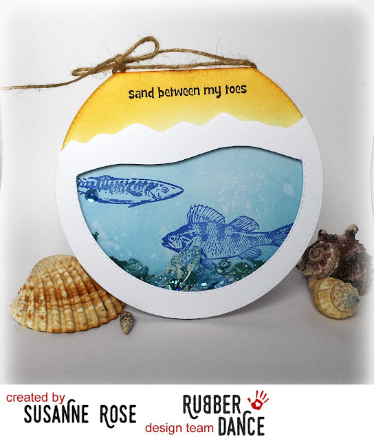 http://rubberdance.blogspot.com/2017/05/on-beach-shaker-card-by-susanne.html