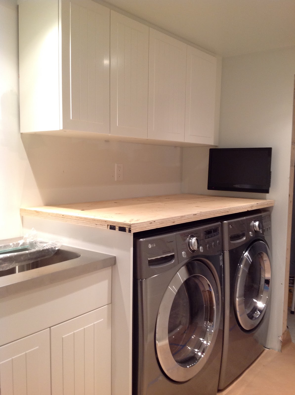 counter over front load washer and dryer, How To Install A Countertop Over A Washer And Dryer, DIY floating countertop in the laundry room, countertop cleat, countertop gable