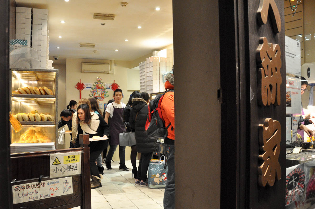 Through the door of a Chinese bakery, Chinatown, London, England