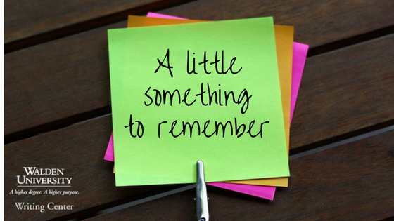 "A set of colorful post-it notes with ""a little something to remember"" written on them"