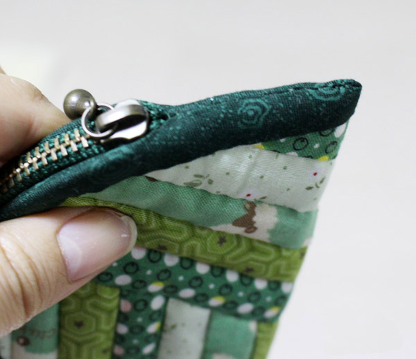 This zip pouch is made with scraps sewn together to form panels, DIY Tutorial