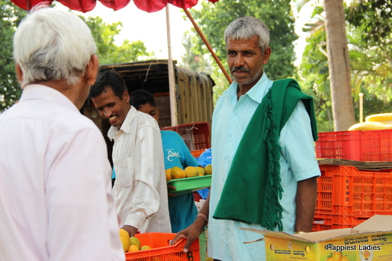 Farmers selling mangoes in mysore