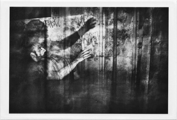 dirty photos - a - dark double exposure photo of scared man