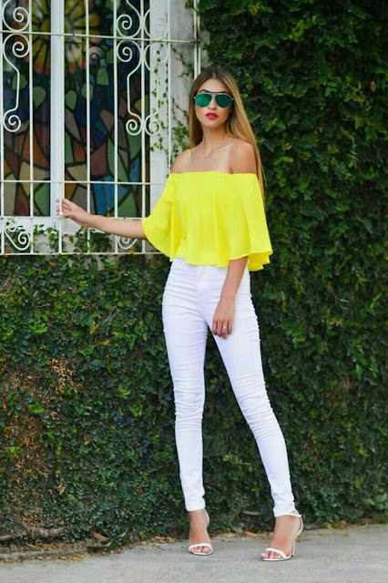 Yellow off shoulder top with white skinny jeans