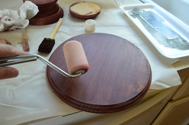 Rolling Brown Paint Onto Craft Rounds