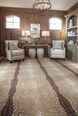 Bold patterned carpet adds a fun design element to this room