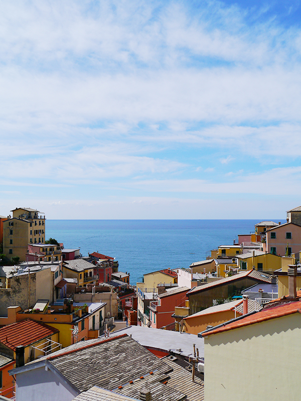 View of colourful houses looking out to the sea from Riomaggiore, Cinque Terre, Italy