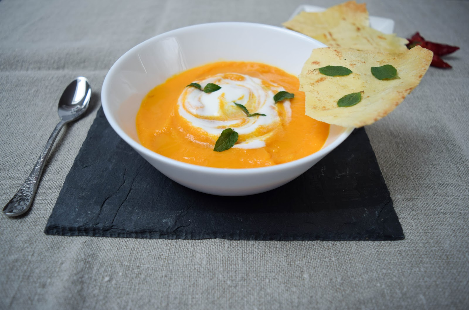 Spicy creamy carrot soup with carasau bread