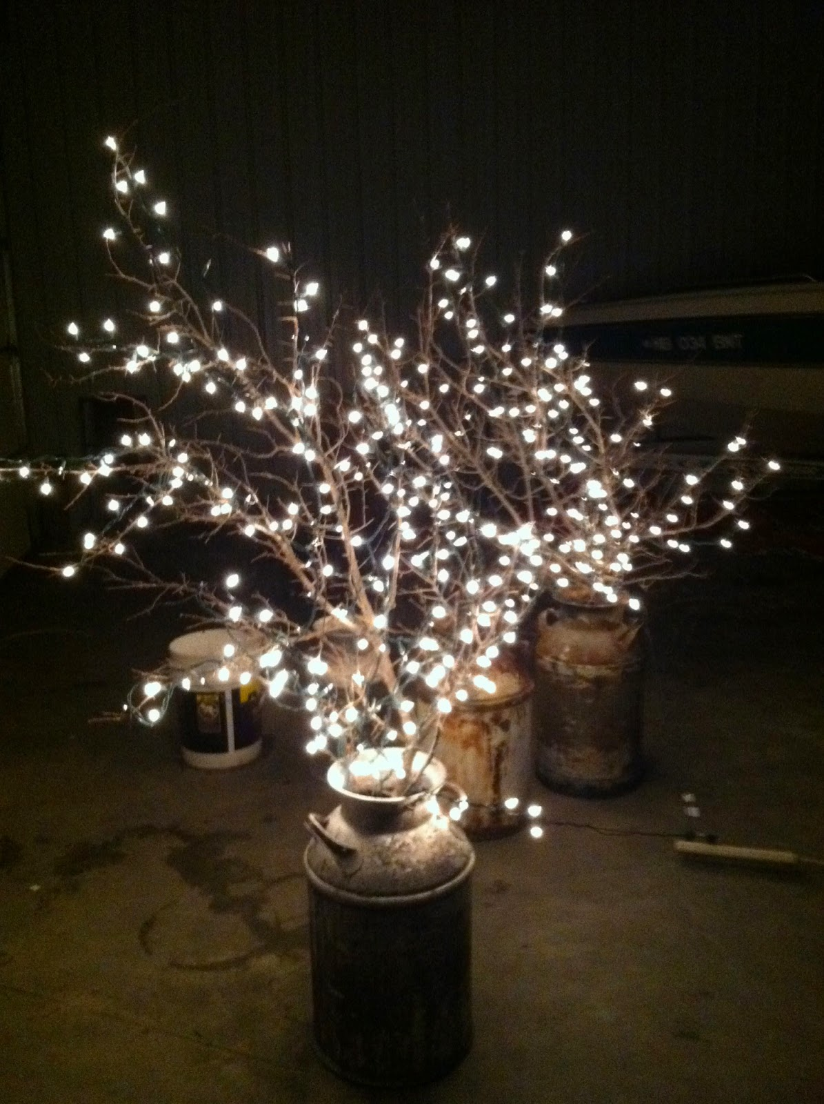 DIY Why Spend More: Milk cans + branches + white lights