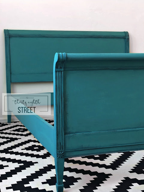 paint layering, dry brushing, adding color layers to furniture, turquoise bed, layering paint on a bed, turquoise headboard