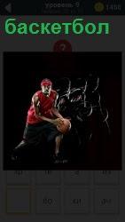 Спортсмен с мячом бежит к кольцу с сеткой для броска мяча в баскетбол