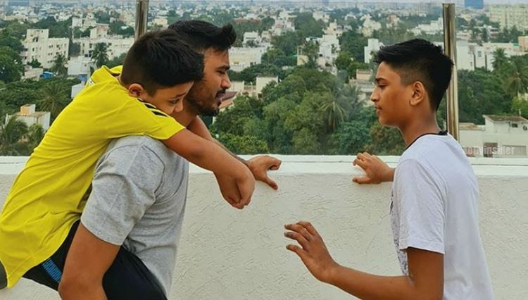 Dhanush plays with his sons Linga and Yatra