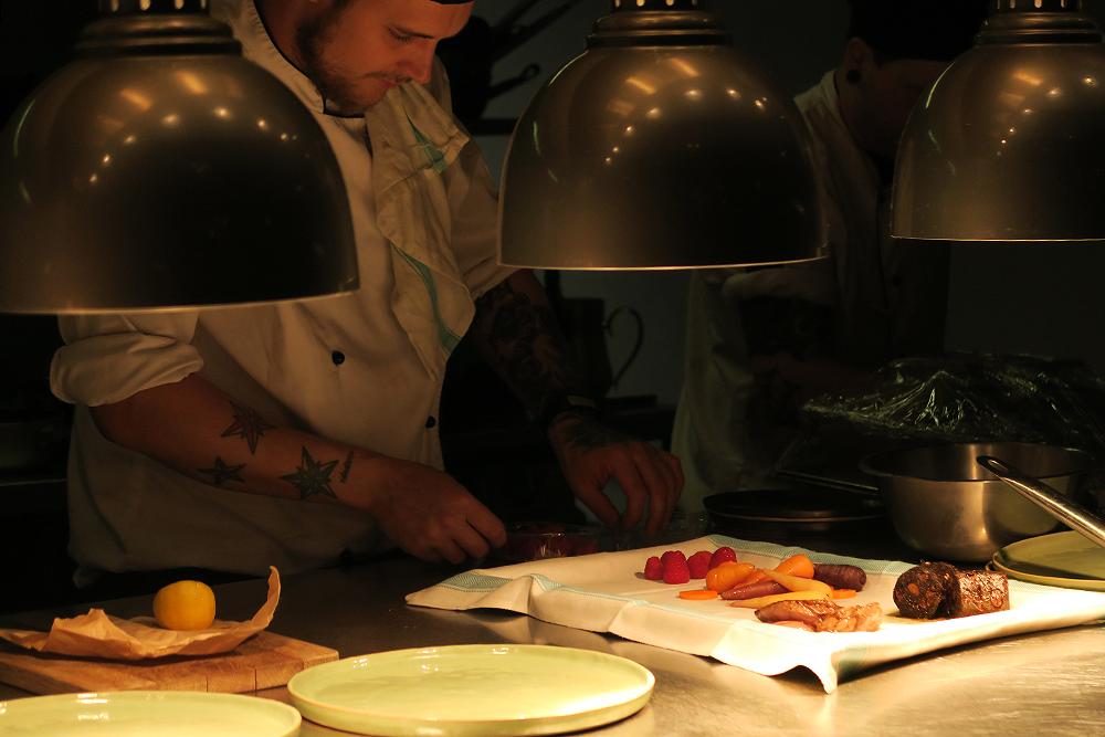 Open kitchen, preparing food at Firelake in Radisson Blu, Leeds