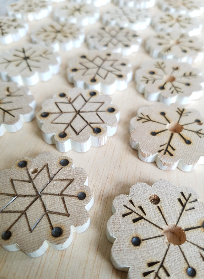 wood burning snowflake designs on wood.
