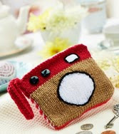 http://www.letsknit.co.uk/free-knitting-patterns/retro-camera-purse