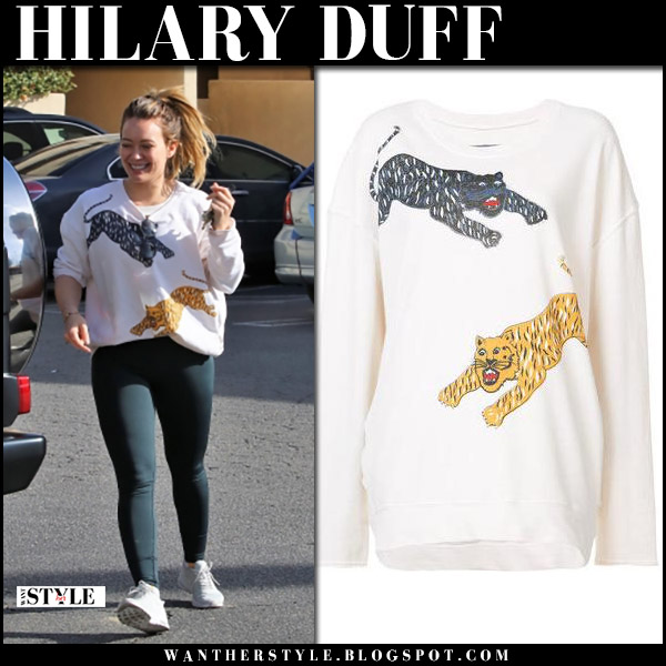 Hilary Duff in white tiger print sweatshirt raquel allegra, black leggings and sneakers nike air max street style january 15