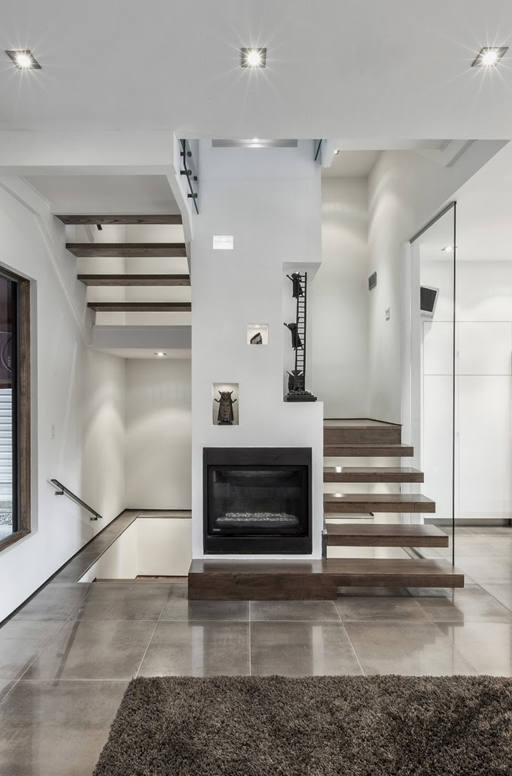 Stairs and fireplace in Small but creative house by rzlbd