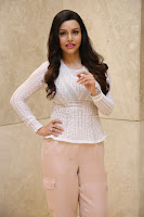 Kyra Dutt in Tight White Top Trousers at Paisa Vasool audio success meet ~  Exclusive Celebrities Galleries 013.JPG