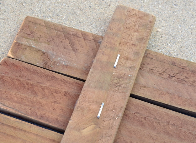 build a base for a rustic sign with scrap wood, glue, and staples