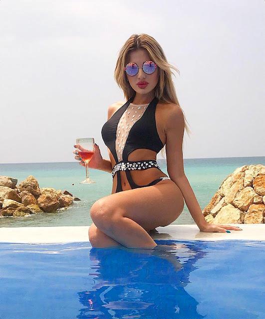 ممثلة وعارضة أزياء لبنانية تشع إنوثة بمايوة أحمر فى أحدث جلسة تصوير
