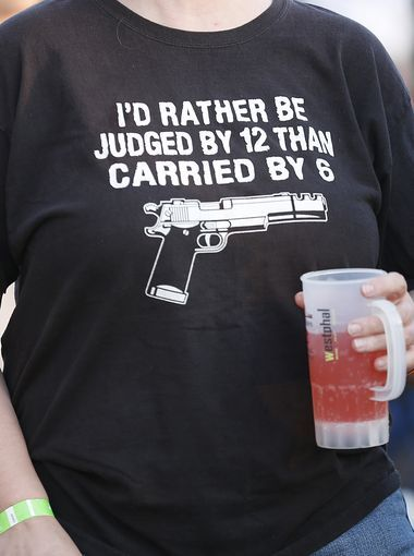"""I'D RATHER BE JUDGED BY 12 THAN CARRIED BY 6"" gun related shirt on PYGOD.COM"