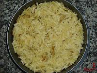 Papas fritas cubiertas con queso