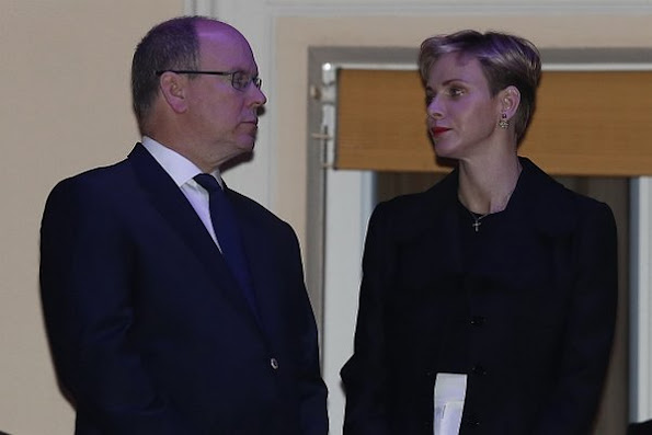 Prince Albert and Princess Charlene of Monaco appear on the balcony of the prince's palace to celebrate Good Friday, diamond tiara, diamond earrings, charlene wedding dress
