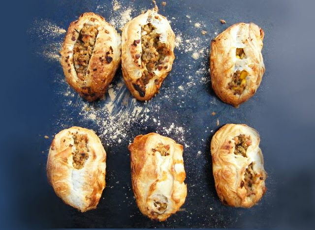 savoury puffs on a baking tray