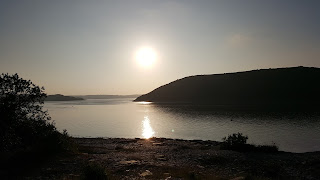Sun setting over the river Camel, Cornwall