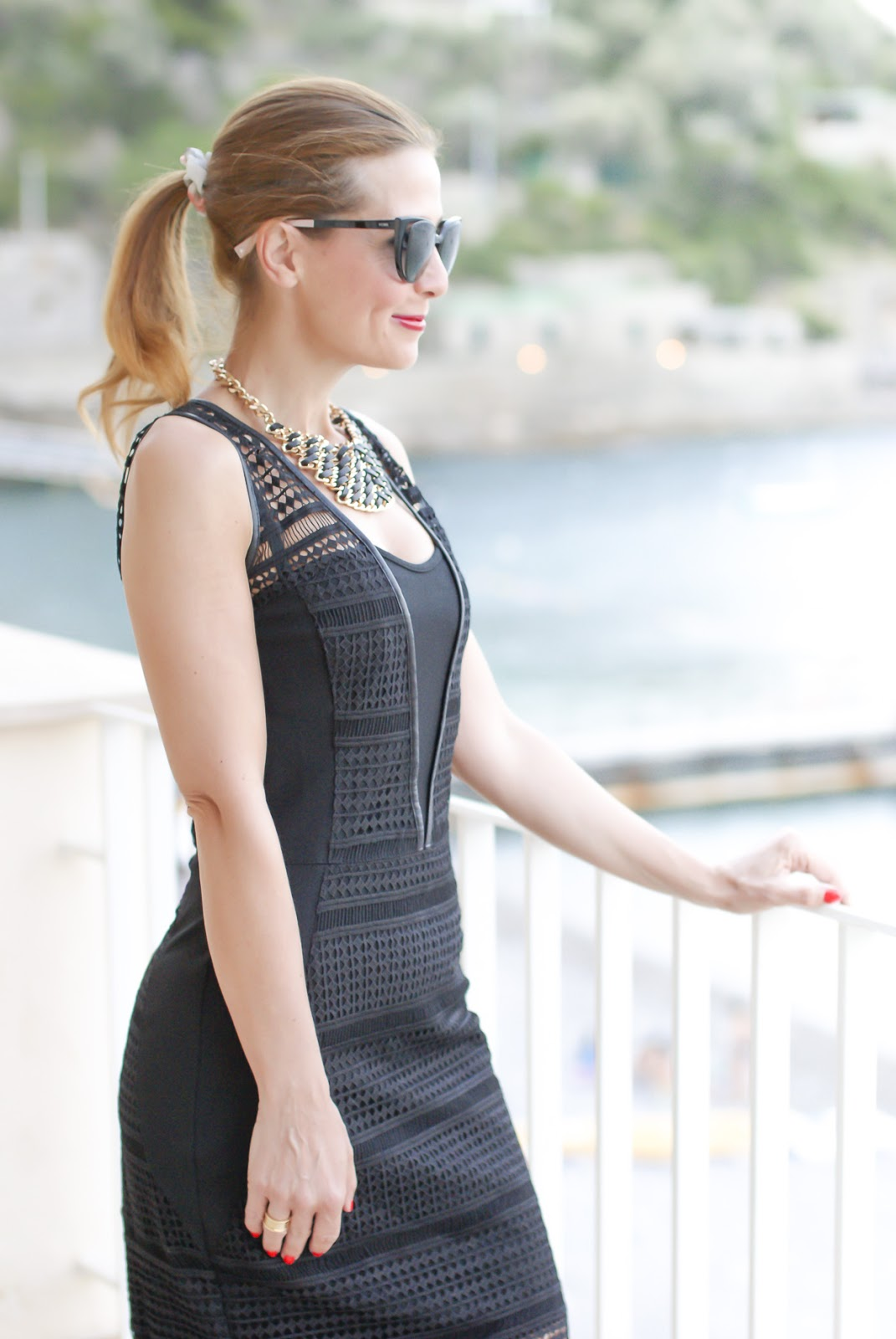 Black bodycon dress with lace and leather inserts on Fashion and Cookies fashion blog, fashion blogger style
