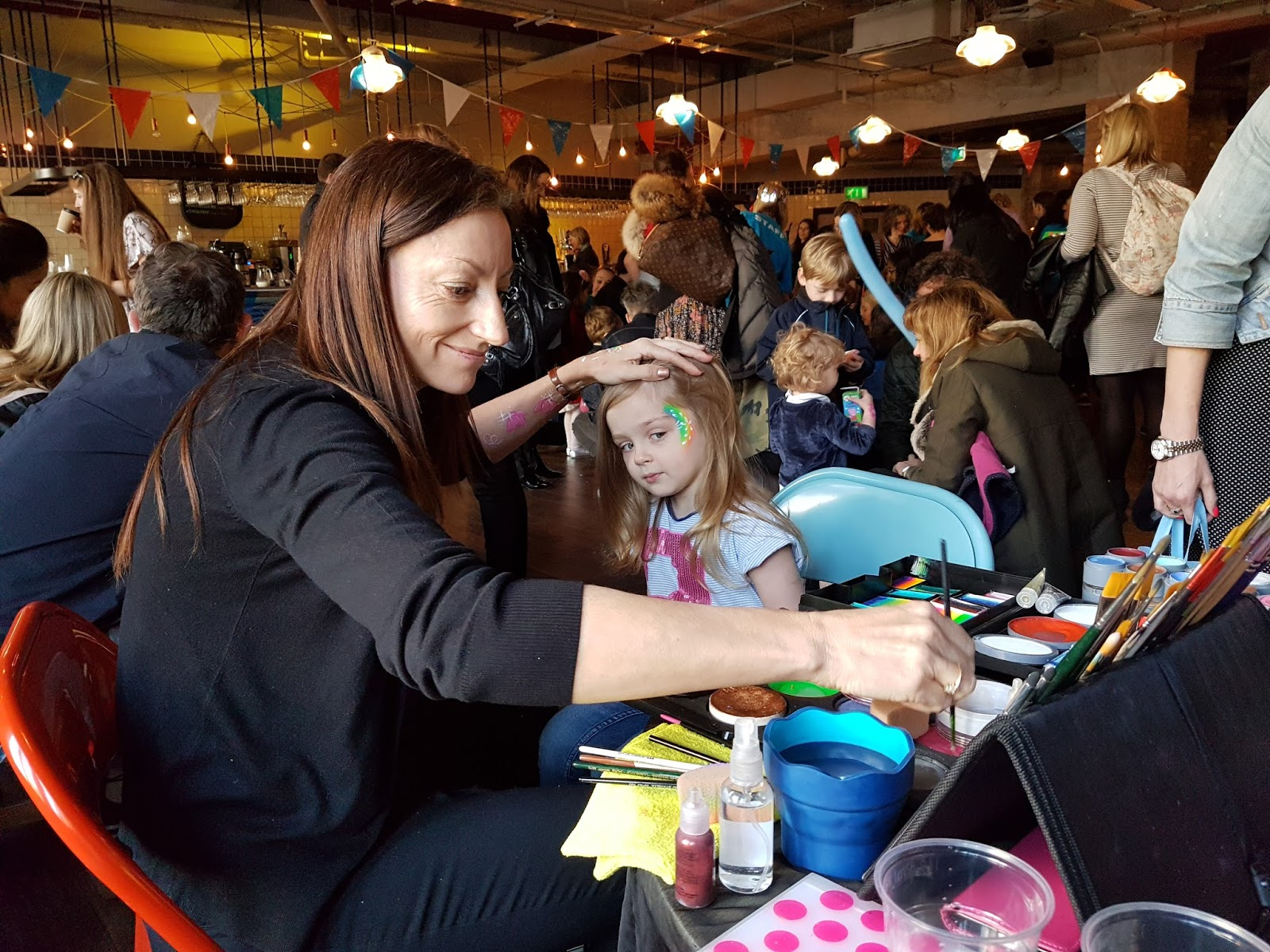 face painting at peppa pig premiere