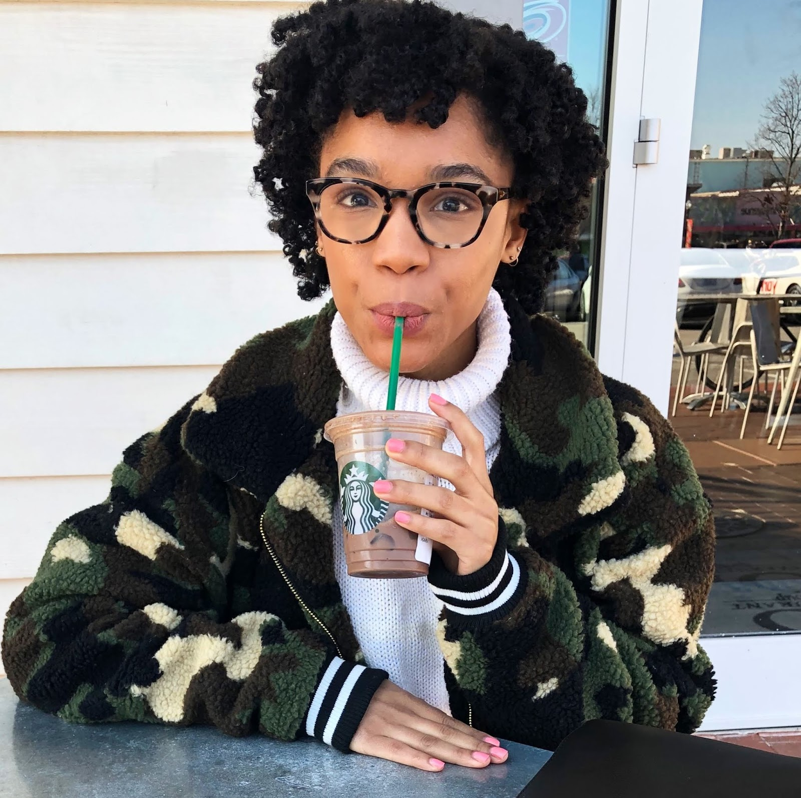 Angelica of The Strong Suit NC fashion and style blogger drinking Starbucks in Camo Jacket