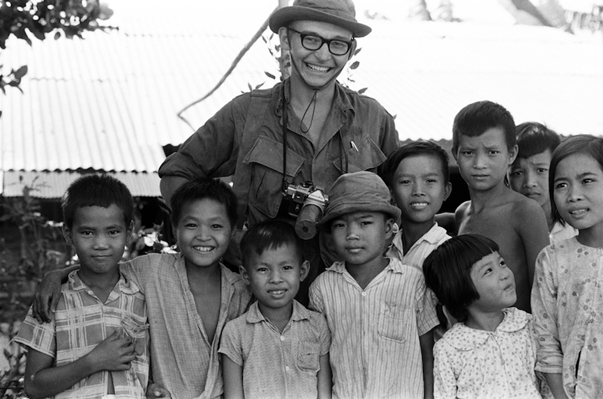 Charlie Haughey poses with Vietnamese school children.