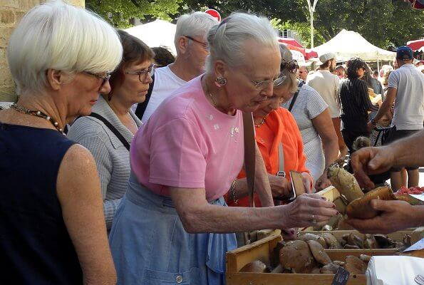 Danish Queen Margrethe visited an open-air market which is in the square outside Cahors cathedral