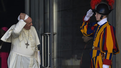 Vatican City: Pope Francis salutes a Swiss guard.