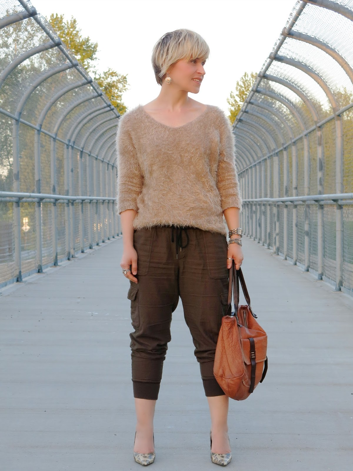 styling slouchy cargo pants with a fuzzy sweater and reptile-print pumps