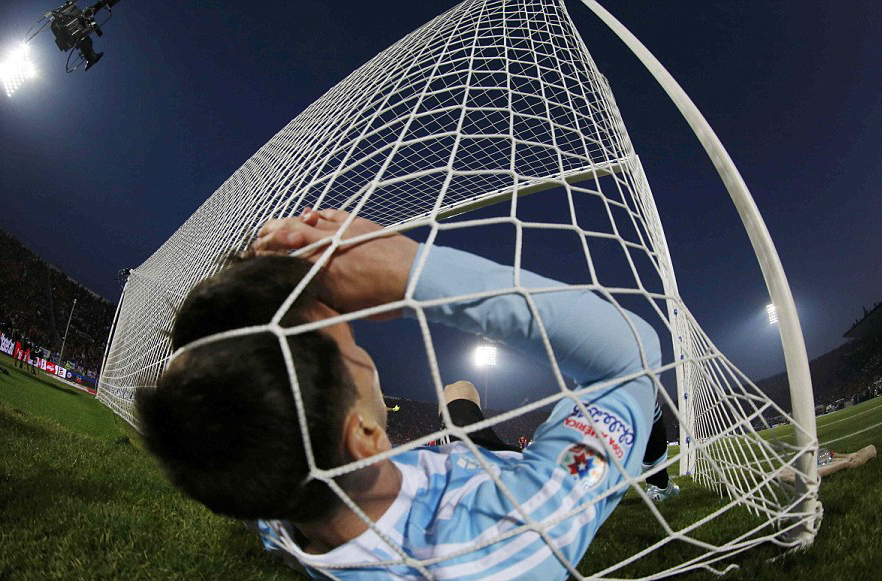 Lionel Messi at the bottom of the net