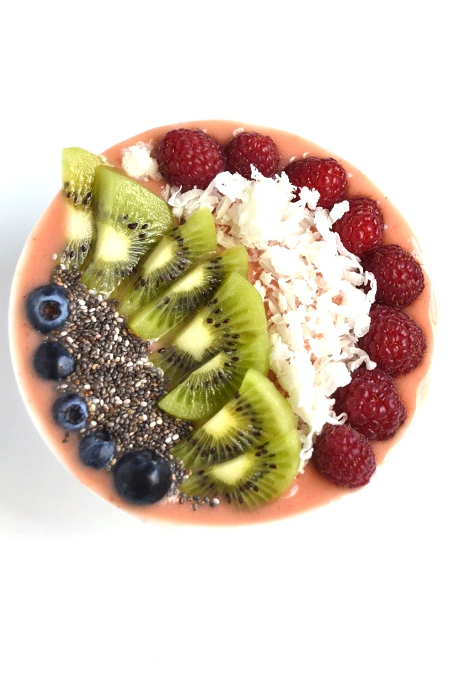 This Tropical Smoothie Bowl makes the perfect breakfast or snack with pineapple, mango and strawberries and tropical toppings! www.nutritionistreviews.com