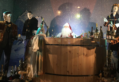 Pic of Santa in bath tub surrounded by Champagne bottles