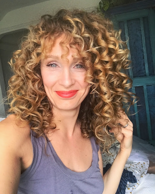 finger coiling curly hair