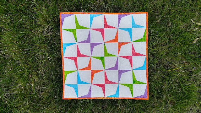 Island Batik paper pieced Boomerang mini quilt by Slice of Pi Quilts