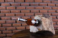 Castiga un suport din sandstone pentru sticle de vin