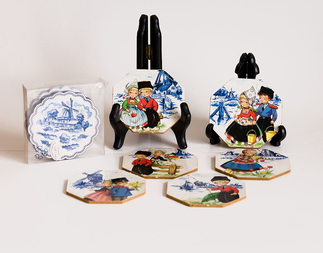 Coloured Delft coasters (ceramic) with cute Dutch boys and girls, and fluted coasters in blue and white with windmills.