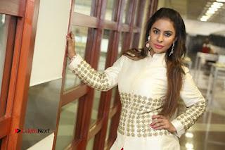 Telugu Actress Sri Reddy Mallidi Stills in White Beautiful Dress at Marriage Needs Bridal Fashion Week 2017 Logo Launch  0041.JPG