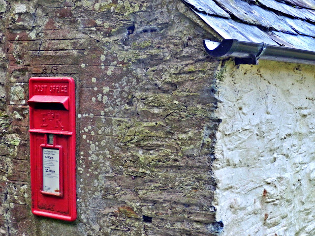 Red postbox in wall at Trenarren, Cornwall