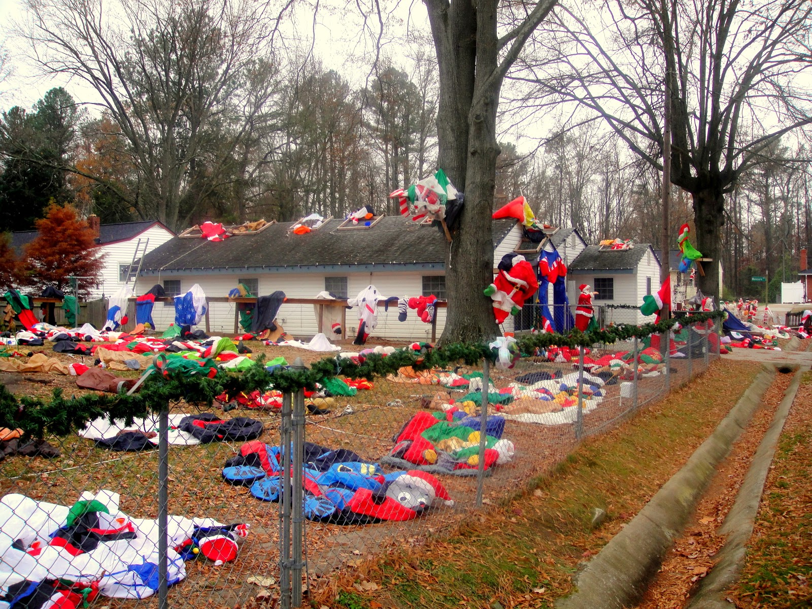 My Neighbor S Lawn With All Of Its Deflated Christmas Inflatables Looks Like A Grisly North Pole Crime Scene